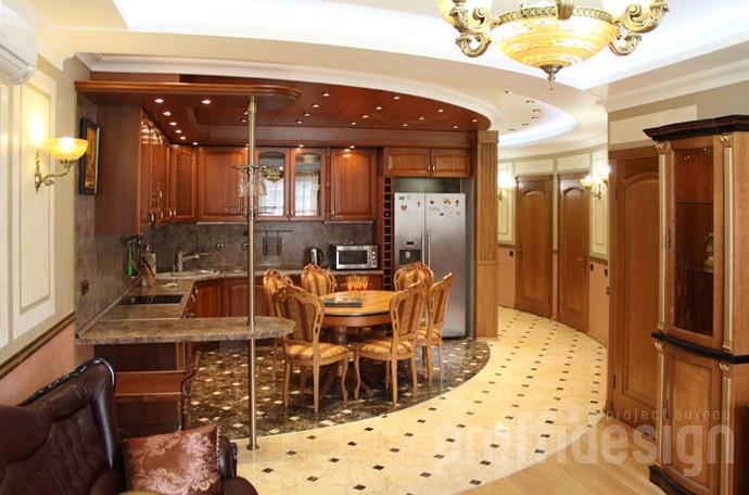 Дизайн квартиры в классическом стиле, открытая кухня, визуально отделённая от гостиной
